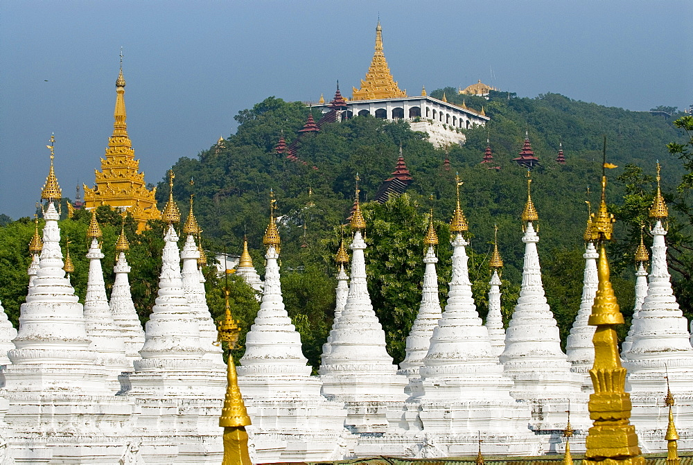Many white, golden-tipped stupas forming several rows, Mandalay, Myanmar (Burma), Southeast Asia