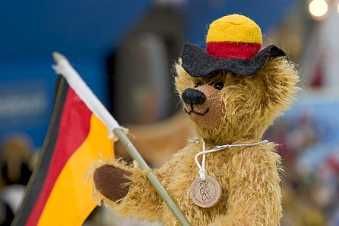 Munich, GER, 01. July 2006 - Teddybear with german flag and a black-red-gold coloured hat