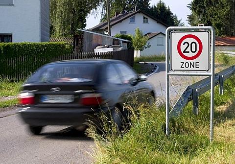 Markt Schwaben, GER, 26. June 2006 - A car passes a sign which marks the begin of a speed limited zone in Markt Schwaben Bavaria Germany.