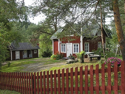 Traditional red wooden country house Kannuskoski near Kouvola, Finland