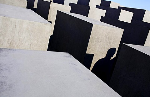 Light and shadows between the concrete slabs of the Holocaust Memorial (Memorial to the Murdered Jews of Europe) in Berlin, Germany