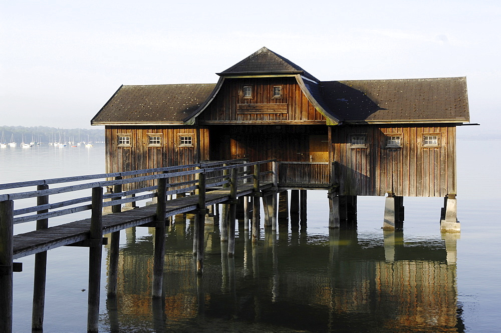 Building on stilts, wooden house, Stegen, Lake Ammersee, Upper Bavaria, Germany, Europe