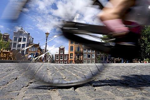 Cyclist, gabled houses, Singel, Amsterdam, Netherlands, Europe