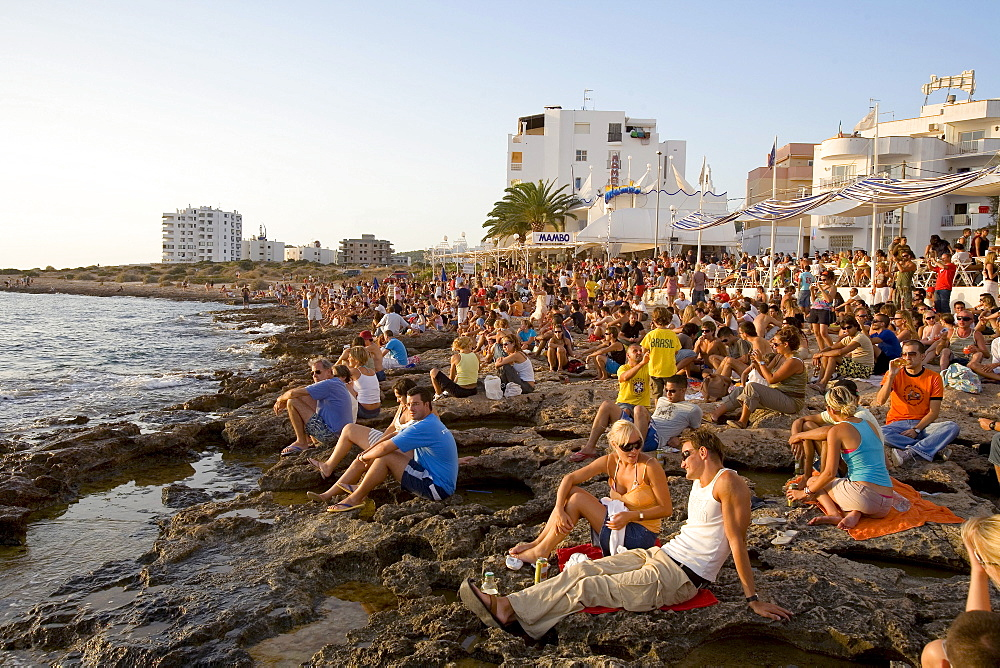 People watching the sunset in front of the Cafe del Mar, Sant Antoni de Portmany, Ibiza, Balearic Islands, Spain, Europe