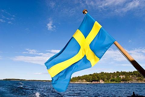 Swedish flag on a ferry, Stockholm archipelago, Sweden