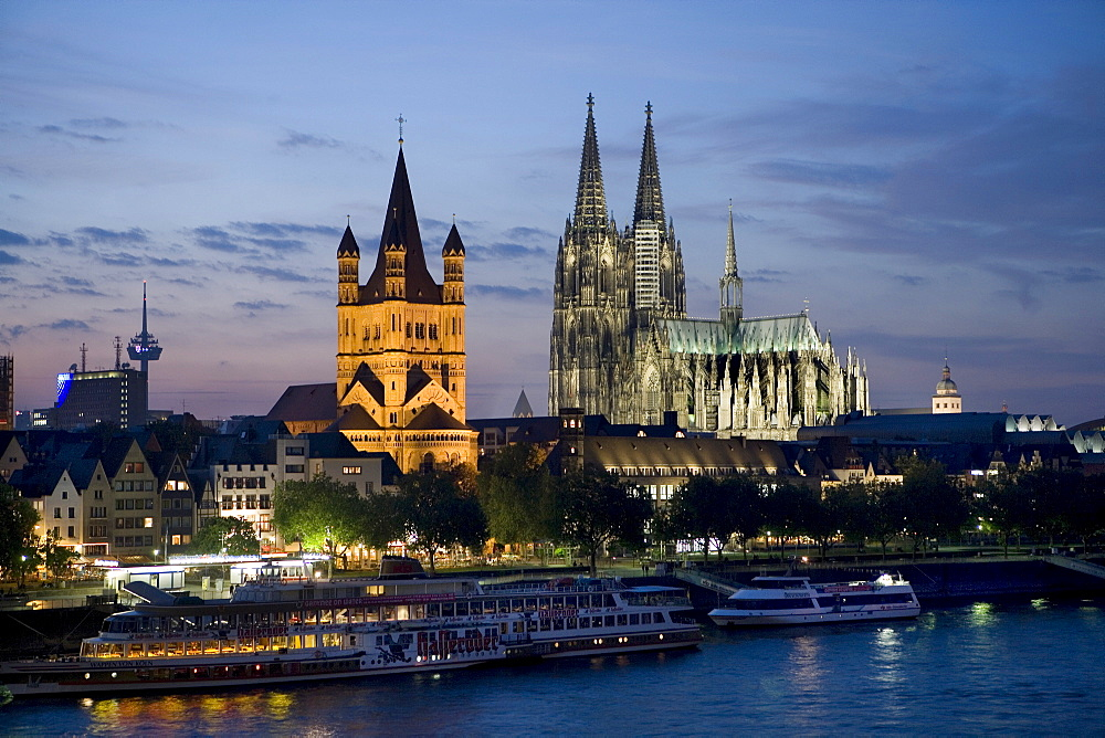 Cologne Cathedral and Great St. Martin Church behind ships on the Rhine River, Cologne, North Rhine-Westphalia, Germany, Europe