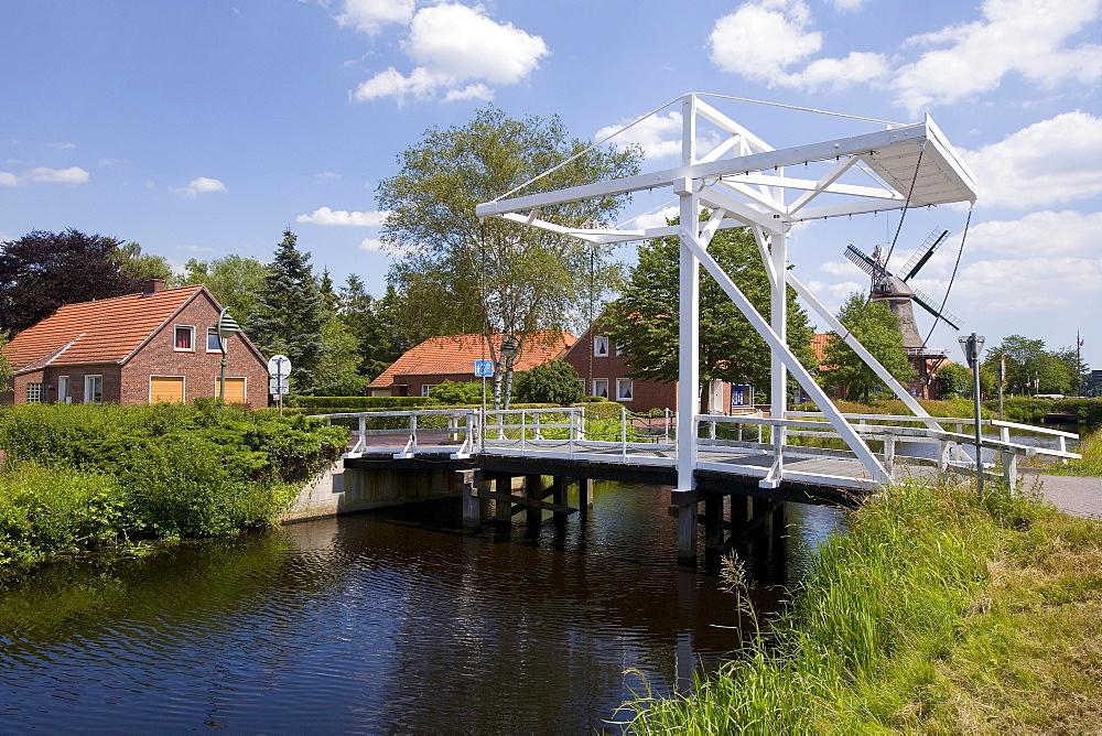 Drawbridge crossing the Grossefehnkanal Canal, Ostgrossefehn, East Frisia, Lower Saxony, Germany, Europe