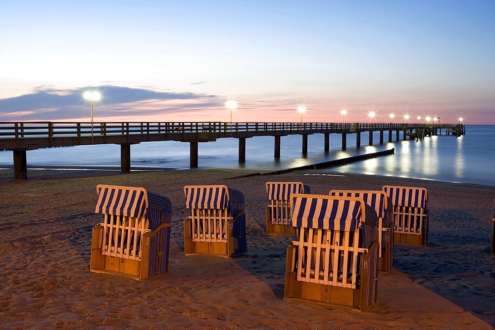 Beach chairs in evening light, pier, Kuehlungsborn, Baltic Sea, Mecklenburg-Western Pomerania, Germany, Europe