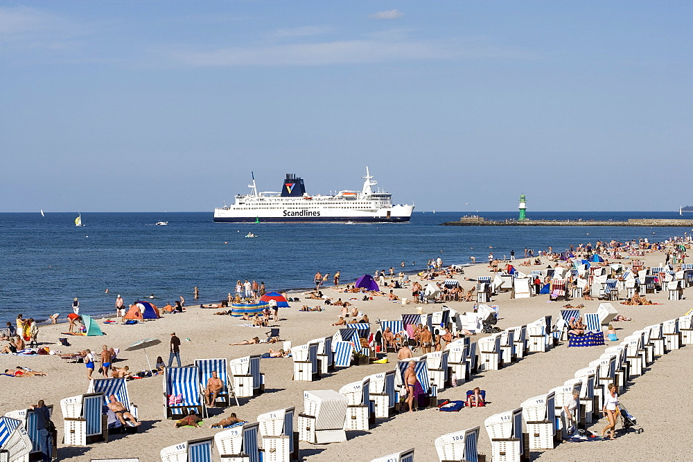 Scandanavian Ferry seen from the beach with roofed wicker beach chairs, Warnemuende, Rostock, Mecklenburg-Western Pomerania, Germany, Europe