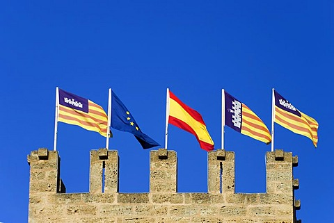 Majorca, Alcudia, flags on the top of a city gate