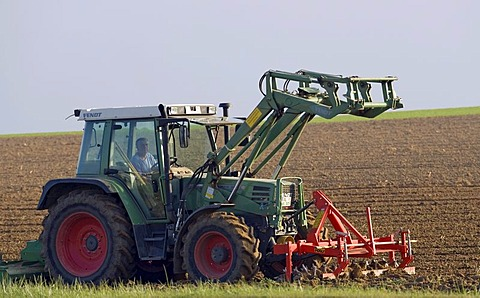 A tractor ploughs