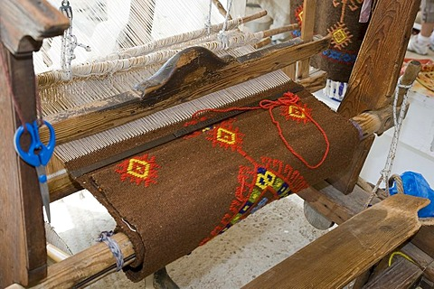A weaving loom with a carpet on it, Crete, Greece
