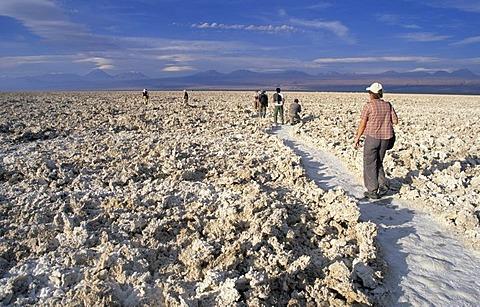 Tourists hiking on Salar de Atacama, Atacama Desert, Chile
