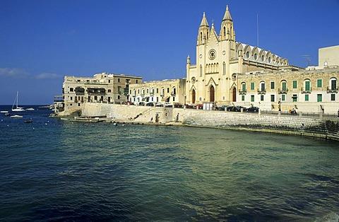 Historic church at a bay in St. Julians, Malta Island, Malta