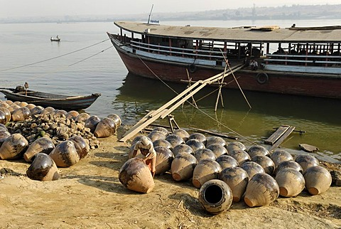 Boat on the banks of Irrawaddy river with Martarban pots, Kyauk Myaung, Myanmar