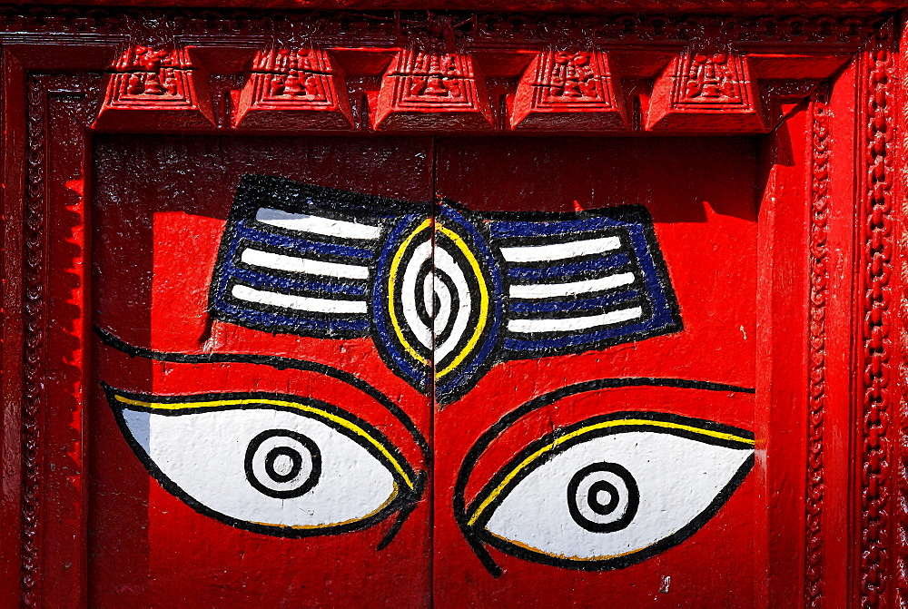 Buddha eyes on a painted door, Kathmandu, Nepal