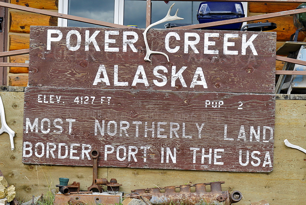 Poker Creek sign on the border between Yukon and Alaska, USA