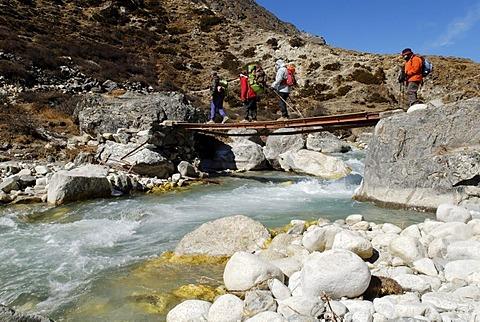 Trekking group on a bridge at Lobuche Khola valley, Sagarmatha National Park, Khumbu Himal, Nepal
