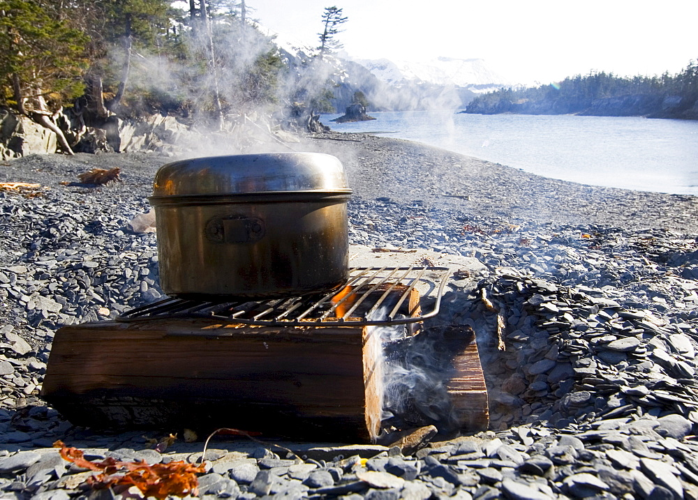 Steaming pot on a campfire, beach, evening, Pacific Coast, Prince William Sound, Alaska, USA
