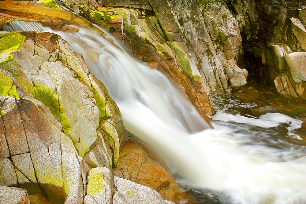 Waterfall on the Etive River tumbling down algae coloured rocks of the almost dry river bed, Glen Etive, Glencoe region, Highlands, Scotland, Great Britain, Europe