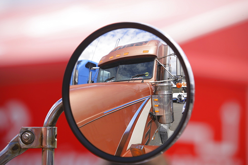 Reflection of a truck in its own rear-view-mirror