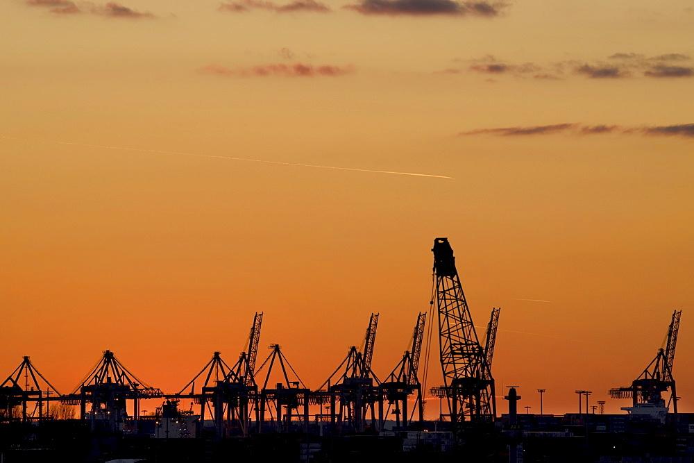 Sunset over the shipping docks in Hamburg, Germany, Europe