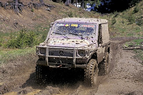 Mercedes G offroad vehicle in mud