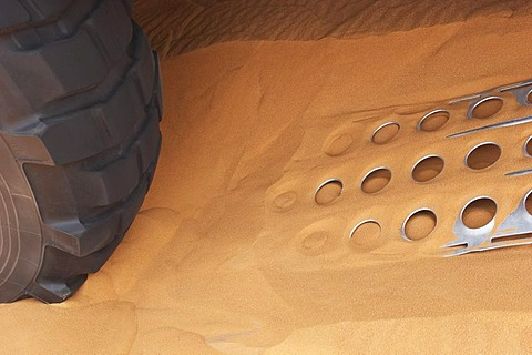 Tire and metal plates for sand in use