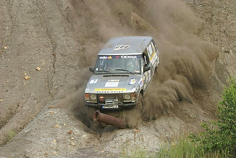 Range Rover 4x4 car dives with speed against a steel pipe or steel tube