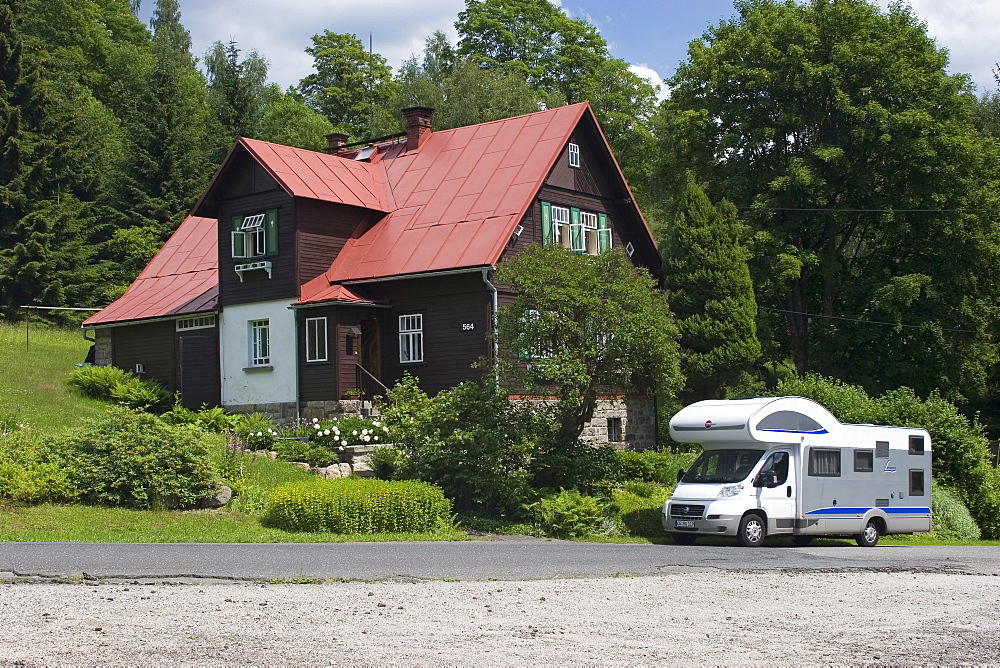 Motorhome in front of residential house, N˝covy Domky, Jizera Mountains, Czech Republic