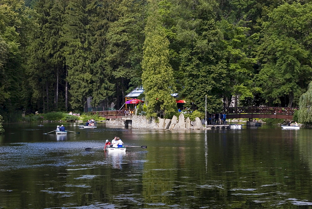 Swan lake in the spa Rajecke Teplice, promenading and rowboats, Slowakei
