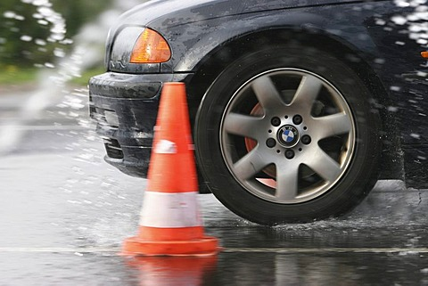 Braking maneuvers during an road safety training with wet conditions