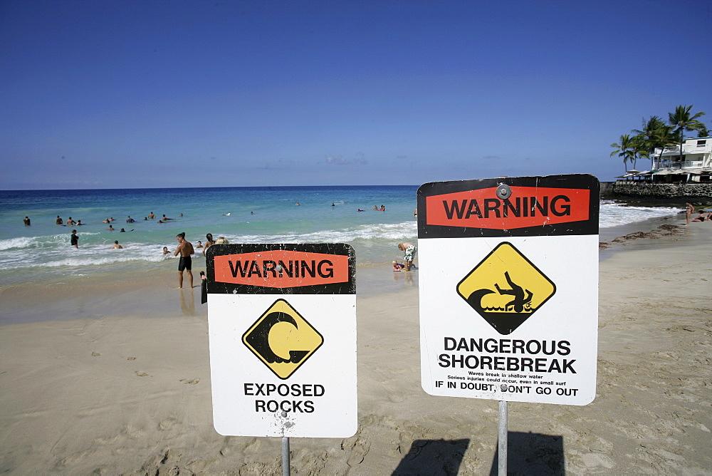 Warning sign at the White Sands Beach in Kailua Kona, Hawaii USA