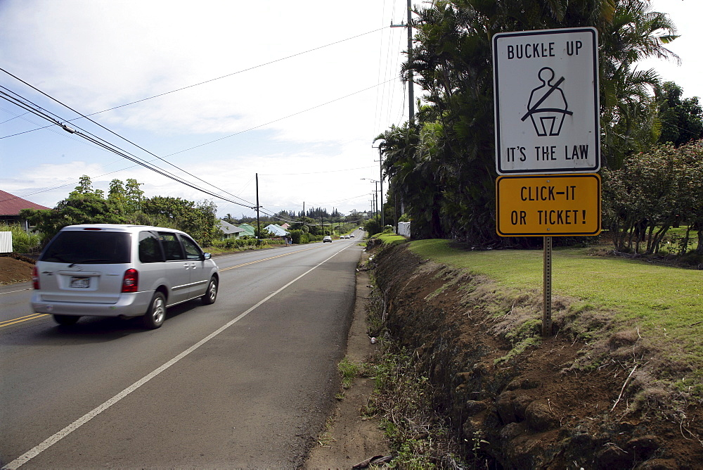 Traffic sign safety seat belt on a street on Big Island, Hawaii, USA