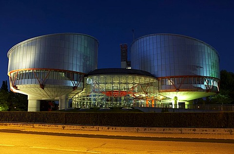 View of the European Court of Justice for human rights with the two cylindrical buildings of the court halls in the evening, Strasbourg, France