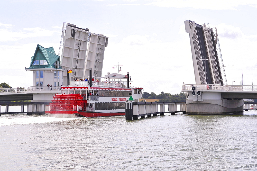 Paddle steamer on the Schlei inlet passing through the bascule bridge at the port in Kappeln, Schleswig-Holstein, Northern Germany, Germany, Europe