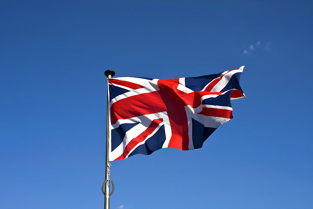 Union Jack, English Flag, Flag of Great Britain, fluttering in the wind on a flagpole
