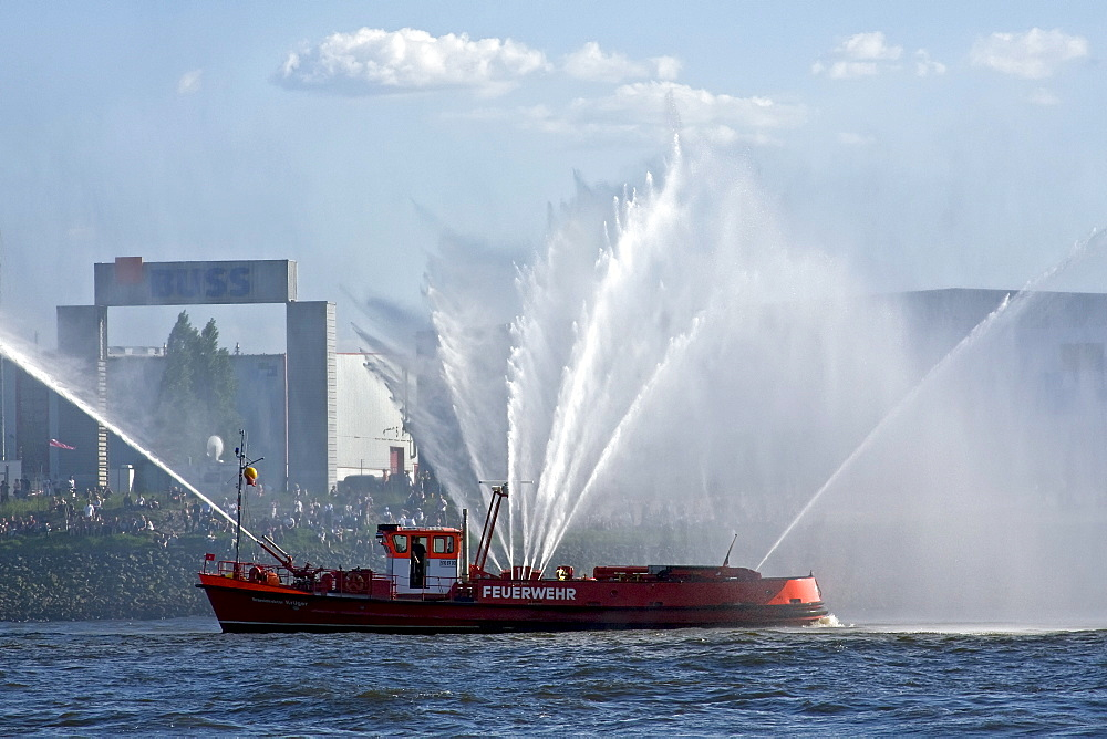 Fire-brigade ship, fireboat of the fire-brigade, demonstrating its water fountains at the celebration of the birthday of Hamburg Port, 2008, Hamburg, Germany, Europe