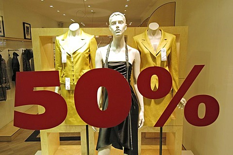Boutique - shop window advertising - shop window with ladies` fashion - 50% discount.