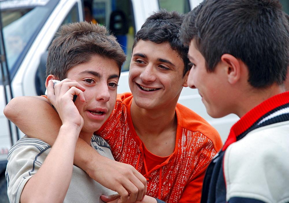 Boys talking on a mobile phone, Yusufeli, Kackar Mountains, northeastern Anatolia, Turkey, Asia
