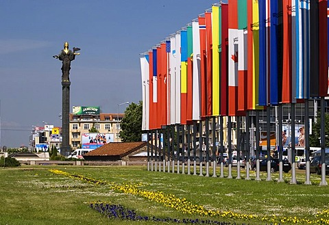 Sofia statue and Nato flags in front of government building, city center, Sofia, Bulgaria