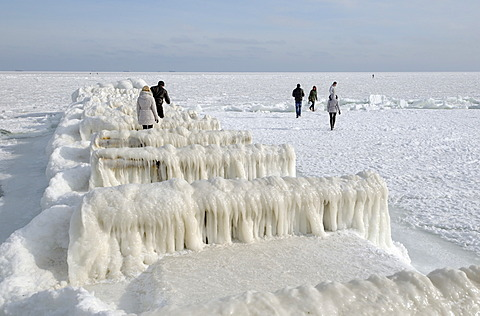 People on icy pier, frozen Black Sea, a rare phenomenon, Odessa, Ukraine, Eastern Europe