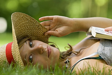 A woman relaxing on the grass