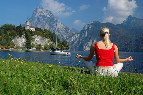 Young blonde woman relaxing at the Traunsee Lake, Salzkammergut resort area, Upper Austria, Europe