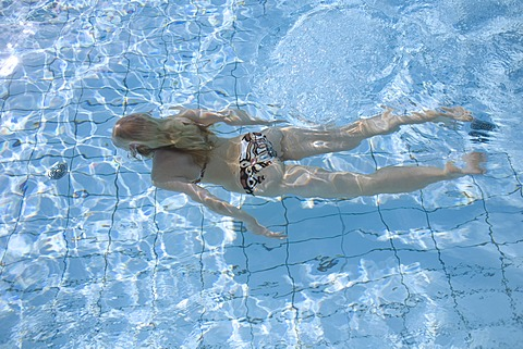 Blond woman swimming in the water