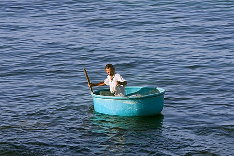 Fisherman in a traditional round boat, Phu Quoc Island, Vietnam, South East Asia, Asia