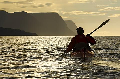 Woman in a kayak, kayak trip to Vigur Island, Ísafjarðardjúp, Isafjardardjup fjord, Westfjords, Iceland, Europe