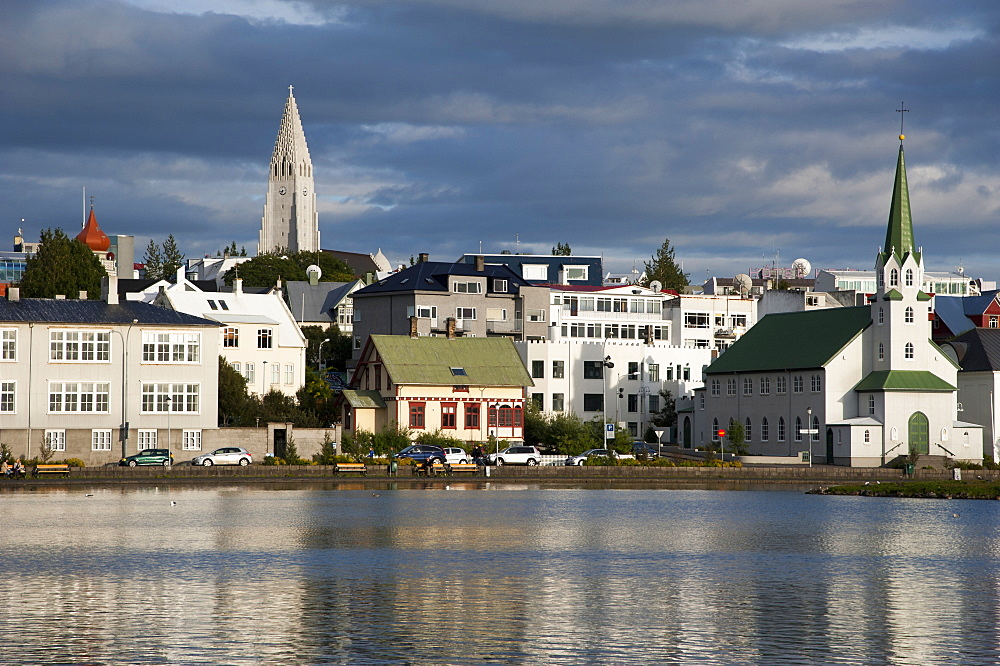 Lake Tjoernin in front of the churches of Fríkirkja and Hallgrímskirkja, Reykjavik, Iceland, Europe