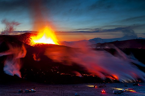 People with Super-Jeeps observing the lava flow from the eruption of the Fimmvoer√∞uh√°ls Volcano, between M√Ωrdalsjoekull and Eyjafjallajoekull, Highland, Iceland, Europe