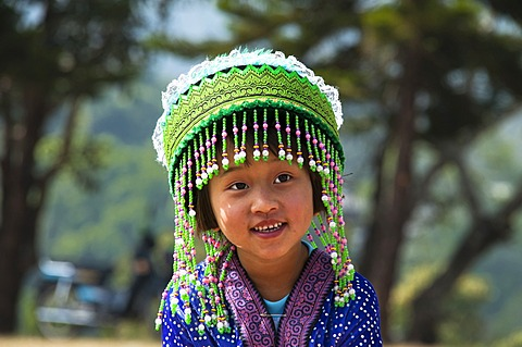 Smiling little girl in a traditional dress, costume, New Year festival, Hmong hill tribe, ethnic minority, Chiang Mai province, northern Thailand, Thailand, Asia